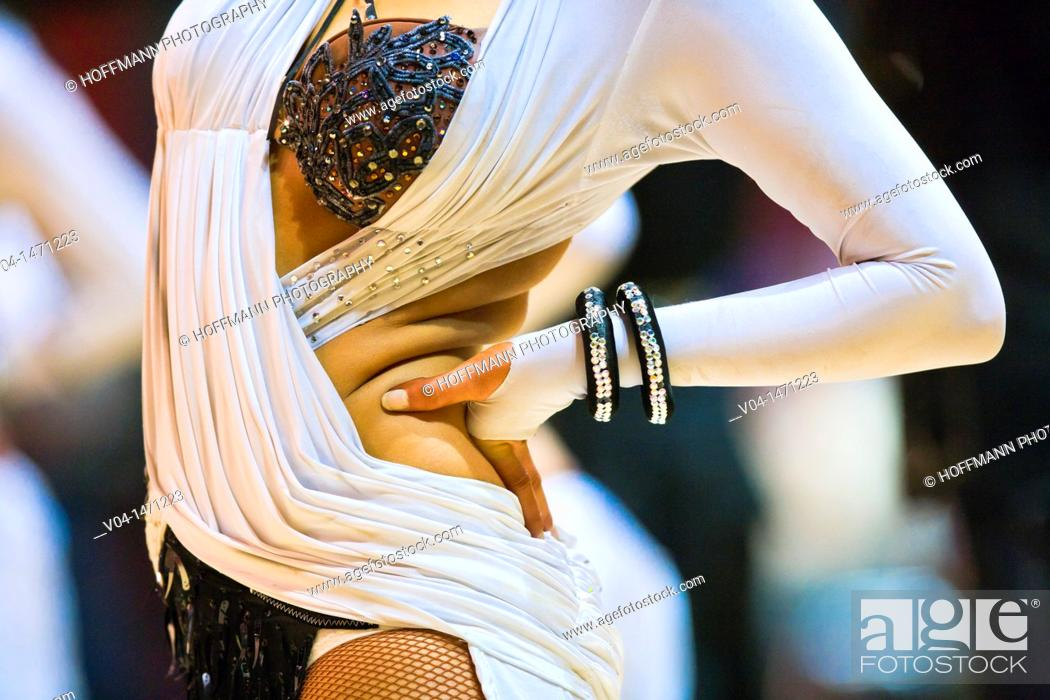 Stock Photo: Close up of a white dress and a female hand at a dancing competition, Germany, Europe.