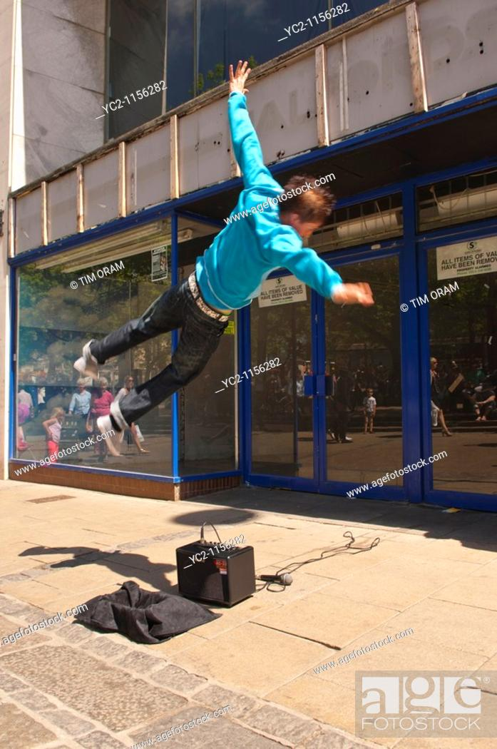 Stock Photo: A Free Runner busking and showing movement in the streets of Norwich , Norfolk , England , Great Britain , Uk.