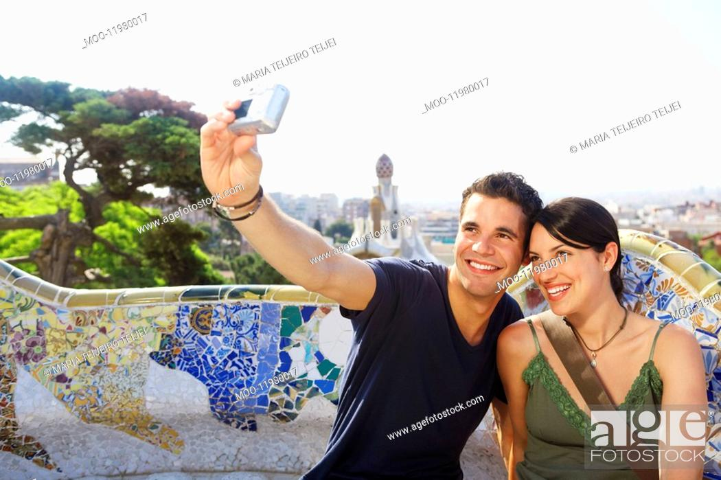 Stock Photo: Smiling couple taking photo of themselves portrait.