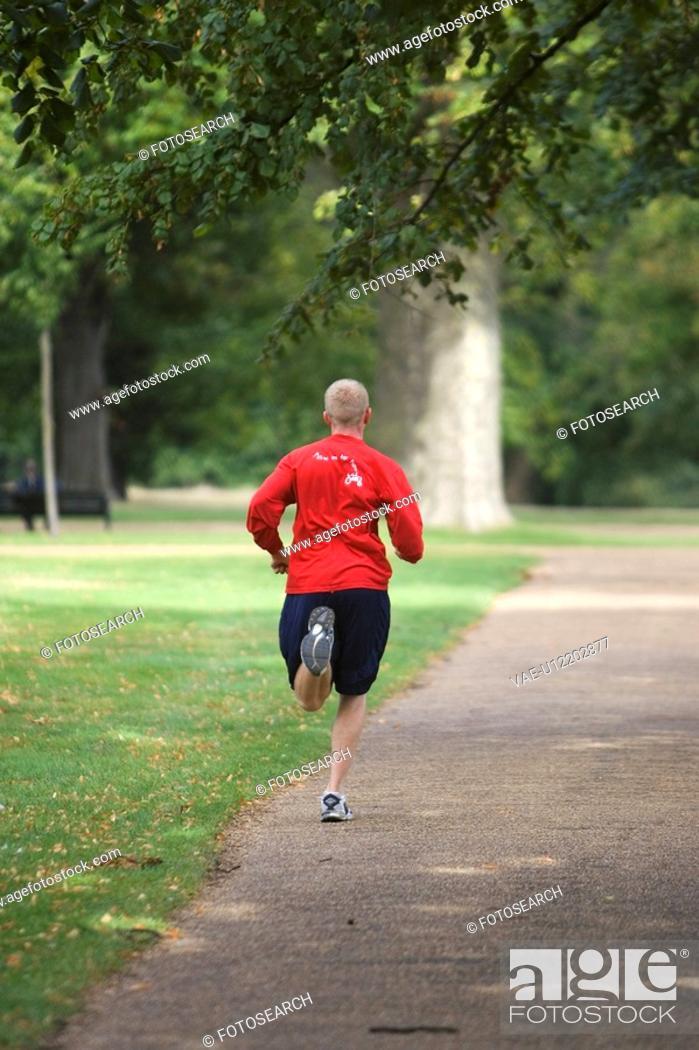 Stock Photo: Focus On Foreground, Jogging, Lush Foliage.