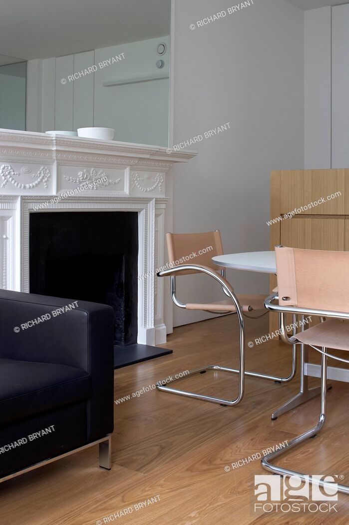 Stock Photo: Table, chairs and original fireplace, Greencroft Gardens Apartment, London.