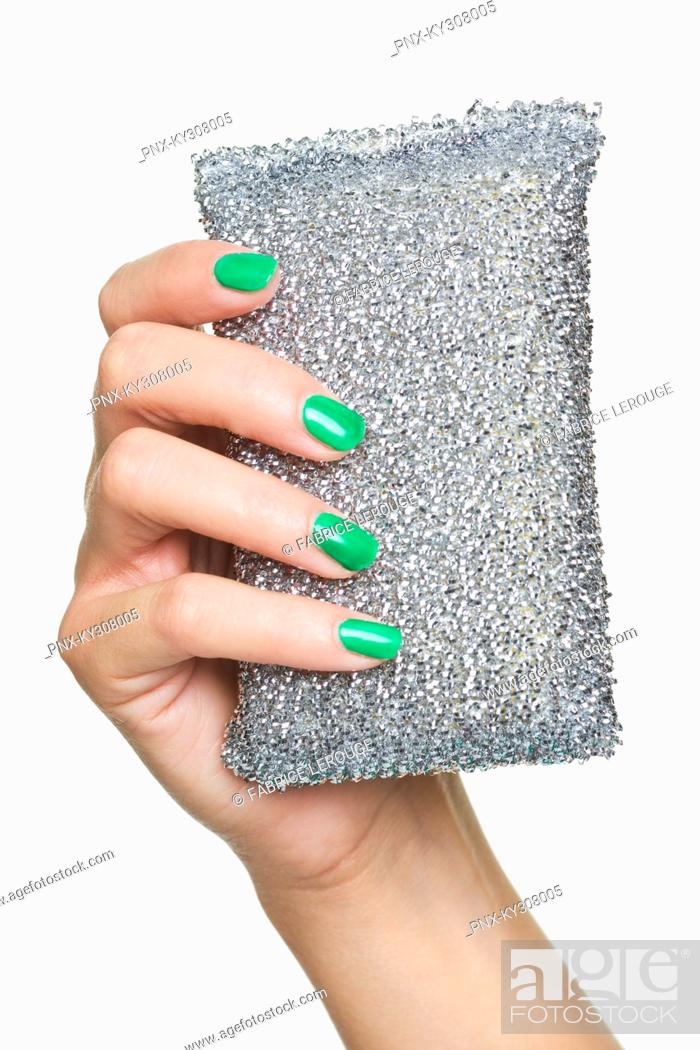 Stock Photo: Close-up of woman's hand holding purse.