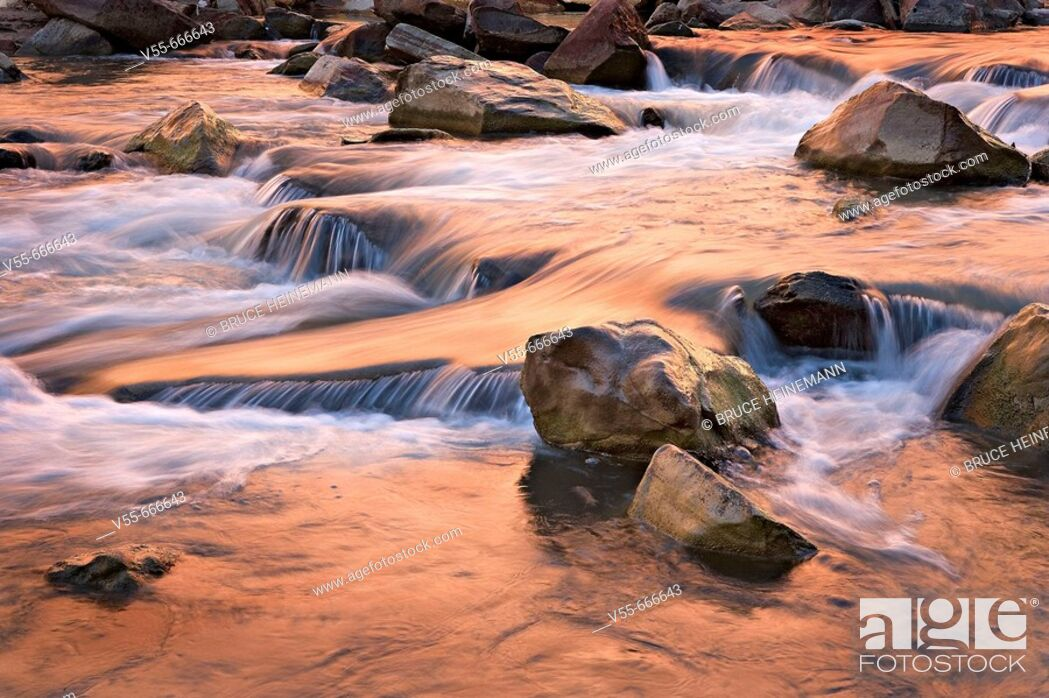 Stock Photo: Autumn colors reflecting in tumbling waterfalls in Virgin River in Zion National Park, Utah, USA.