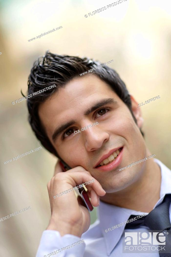 Stock Photo: Business man on phone.