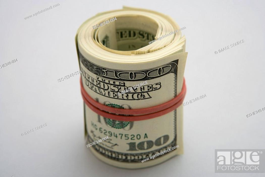 Stock Photo: Roll of banknotes.