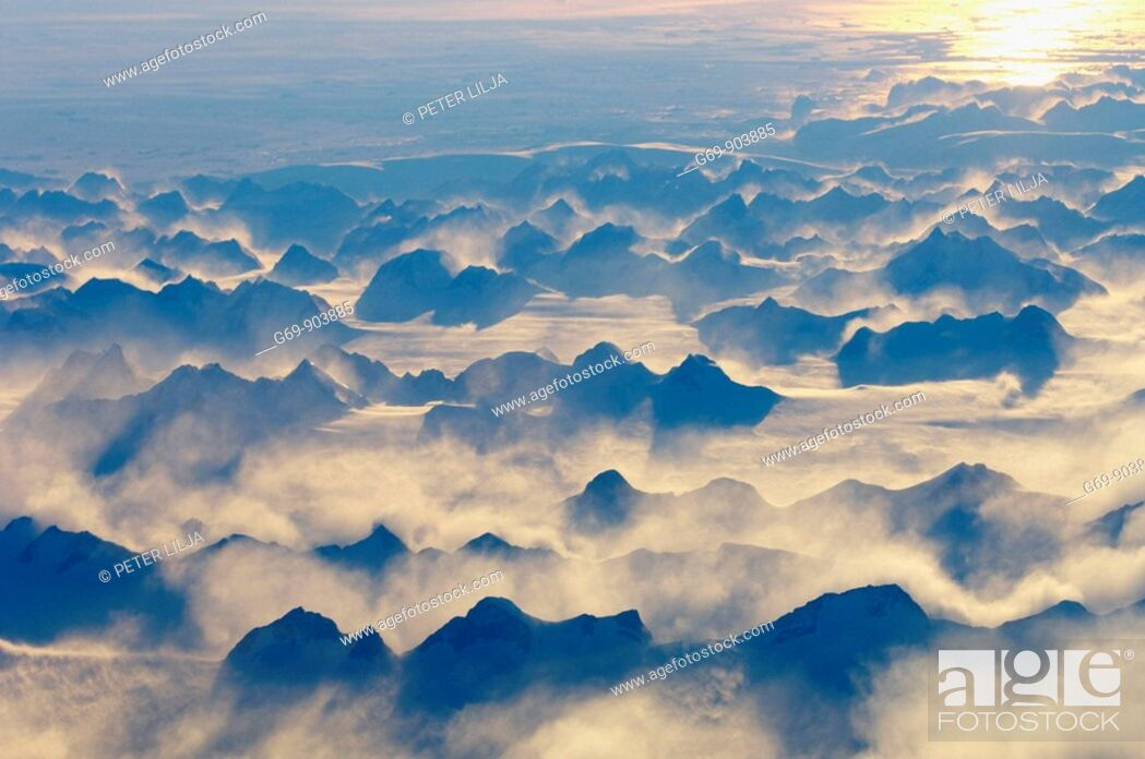 Stock Photo: Evening light over a mountain range on Greenland, from above (October 2005).