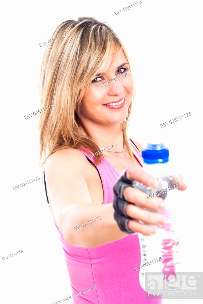 Stock Photo: Close up of young fitness woman holding bottle of water, isolated on white background.