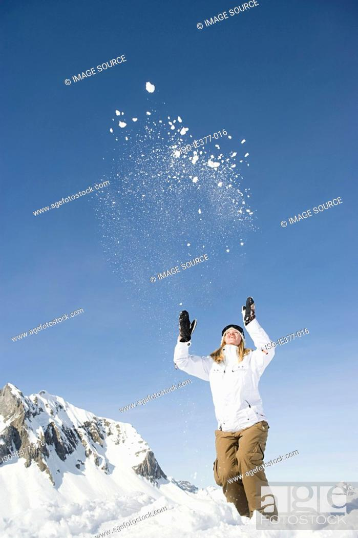 Stock Photo: A woman throwing snow.