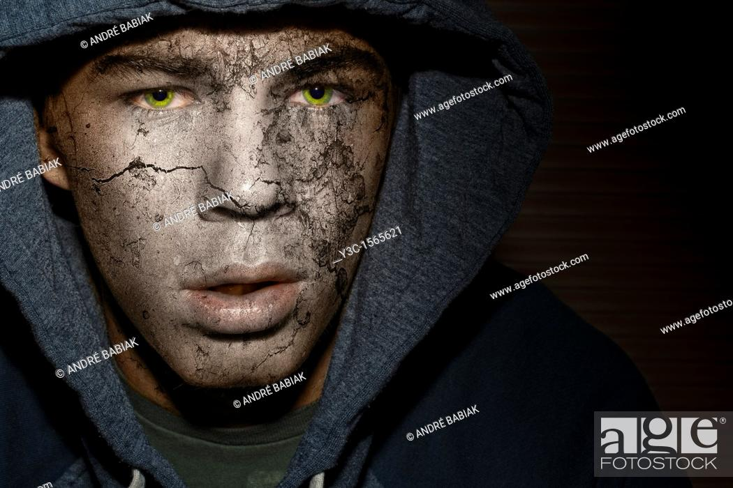 Stock Photo: Male horror face with stone texture.