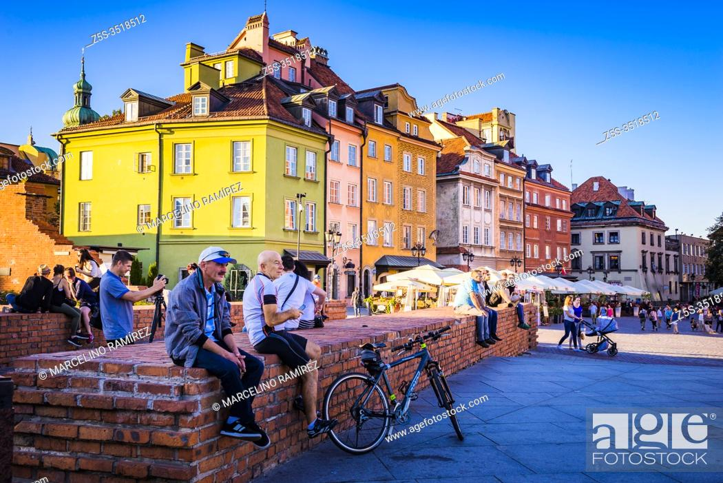 Stock Photo: Tourists and locals relaxing in Castle Square at sunset, Old Town. Warsaw, Poland, Europe.