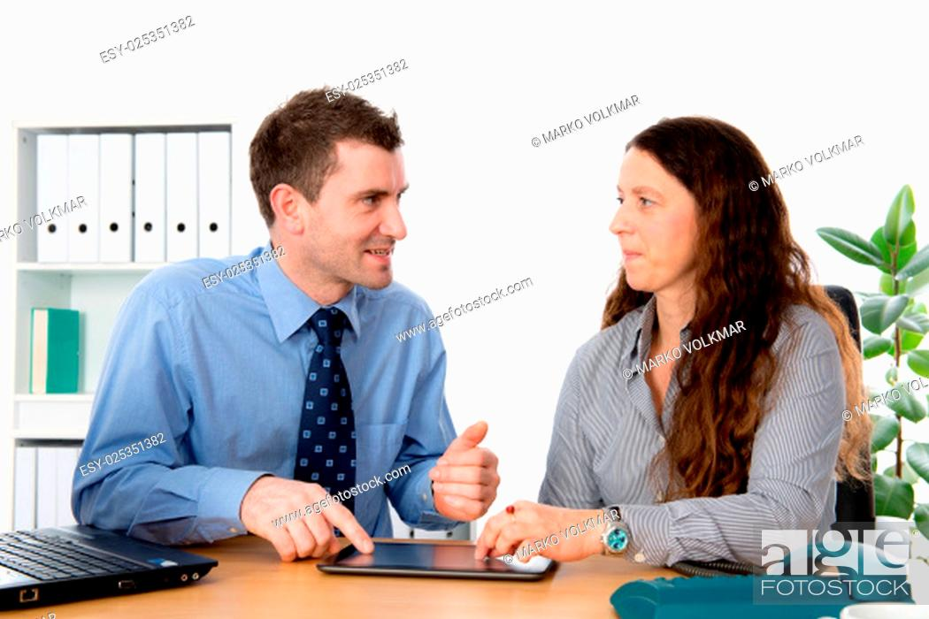 Stock Photo: man and woman together in the office.