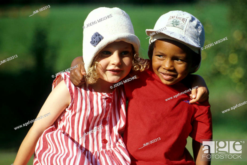 Stock Photo: Two little children, a boy and a girl, 1-5 years old, in the garden in summer.