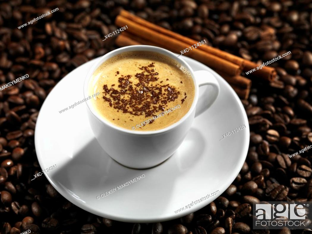 Imagen: Cup of coffe latte with chocolate on coffee beans background.