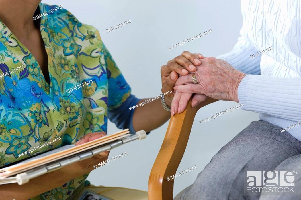 Stock Photo: A nurse consoling a patient.