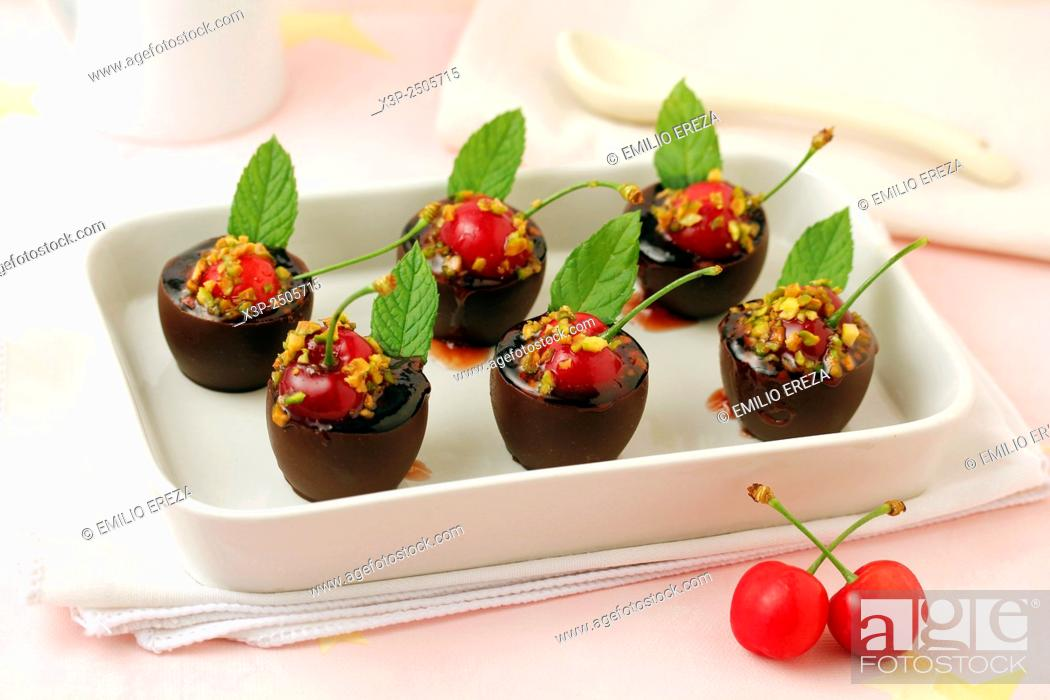 Stock Photo: Chocolate little cups with cherries.