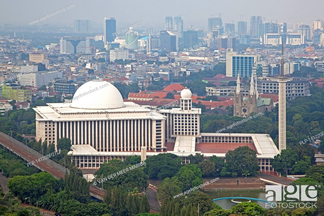 Smog Hanging Over Jakarta And View Over The Istiqlal Mosque Masjid