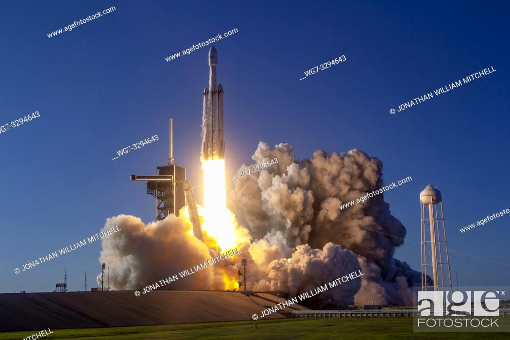 Stock Photo: KENNEDY SPACE CENTRE, FLORIDA, USA - 11 April 2019 - The SpaceX Falcon Heavy rocket launches the Arabsat-6A satellite from Launch Complex 39A at NASA's Kennedy.