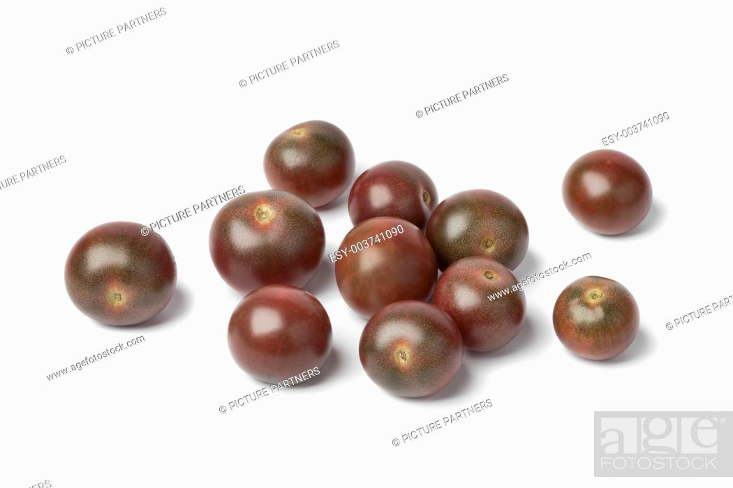 Photo de stock: Brown baby tomatoes on white background.
