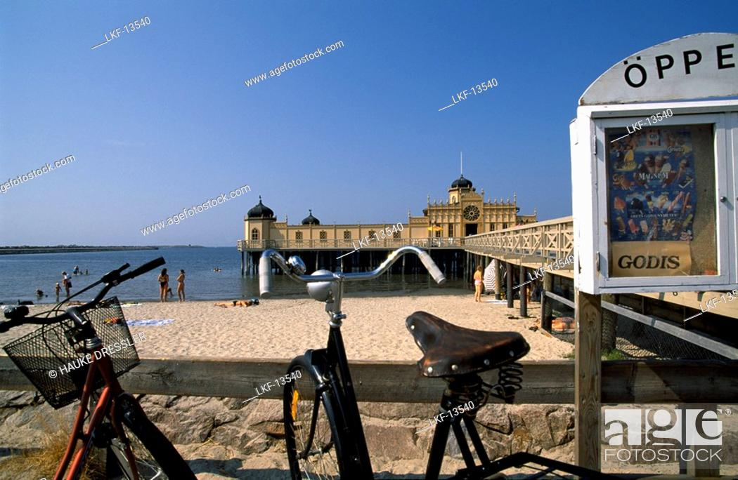Stock Photo: Bikes parked at the beach in front of the Bath House, Kallbadhuset, Varberg, Halland, Sweden.