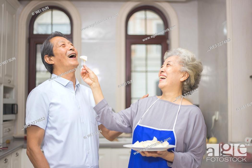 Stock Photo: Elderly couple in the kitchen.