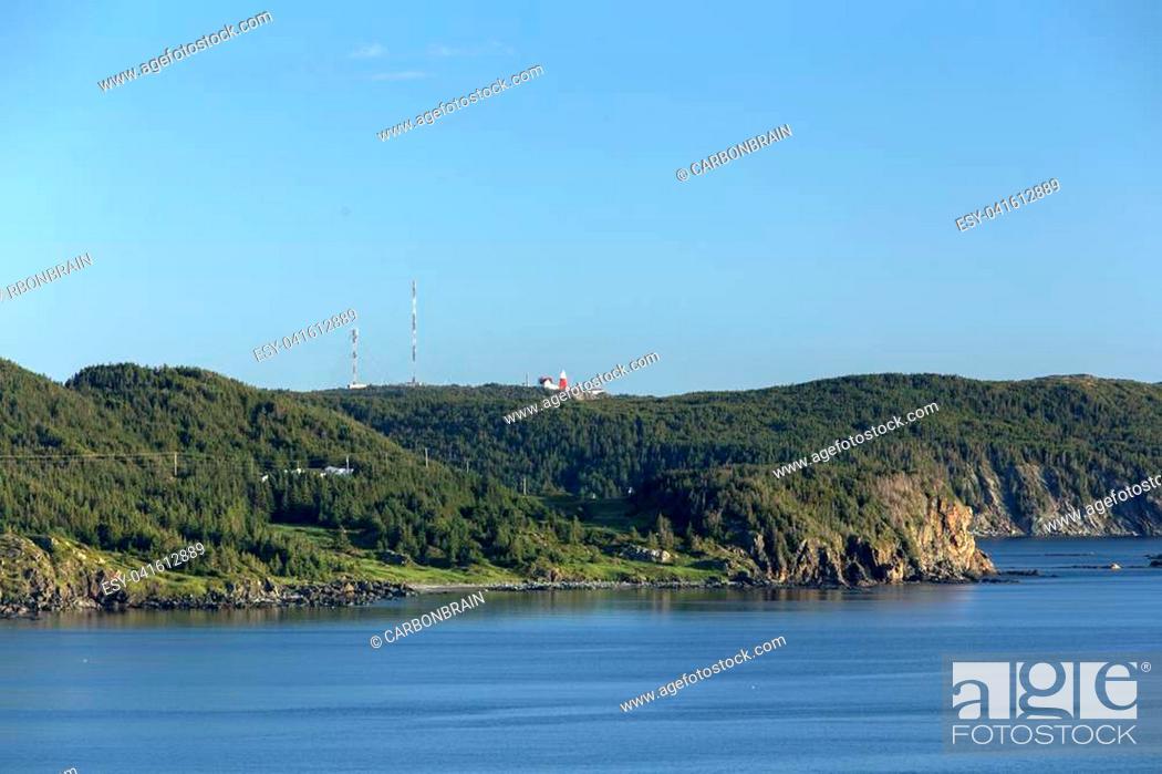 Stock Photo: distant Long Point Lighthouse on Twillingate Island, Newfoundland.