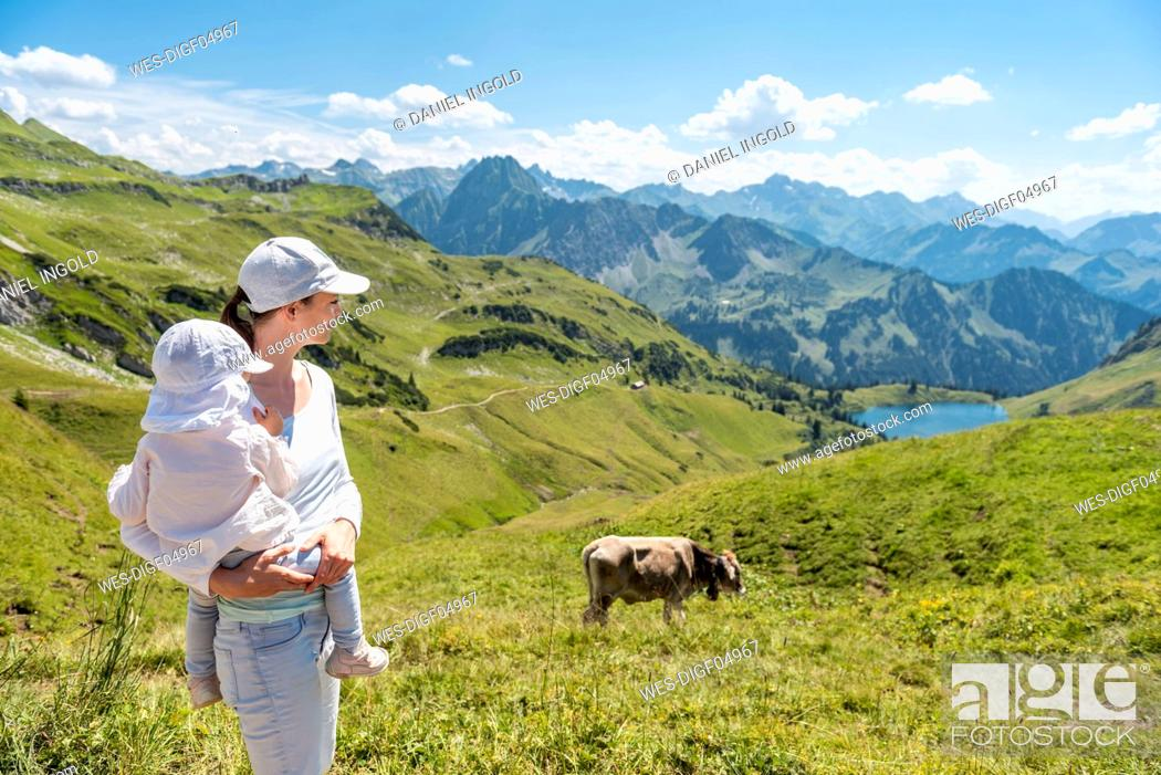 Stock Photo: Germany, Bavaria, Oberstdorf, mother and little daughter on a hike in the mountains.
