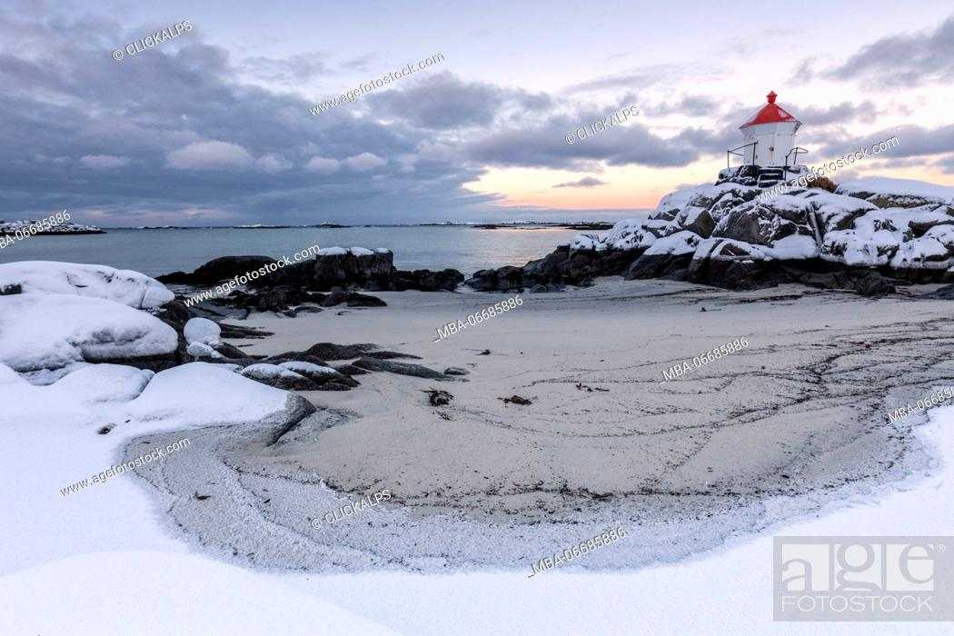 Stock Photo: Colorful arctic sunset on the lighthouse surrounded by snow and icy sand Eggum Vestvagoy Island Lofoten Islands Norway Europe.