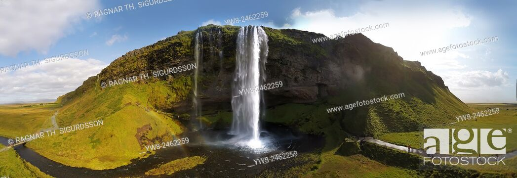 Stock Photo: Seljalandsfoss Waterfall in the summer, panoramic view, shot using a drone, Iceland.