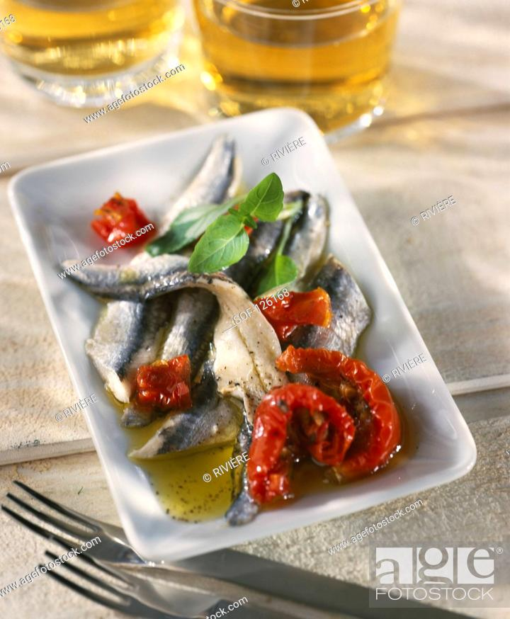 Stock Photo: sardines marinated in olive oil.