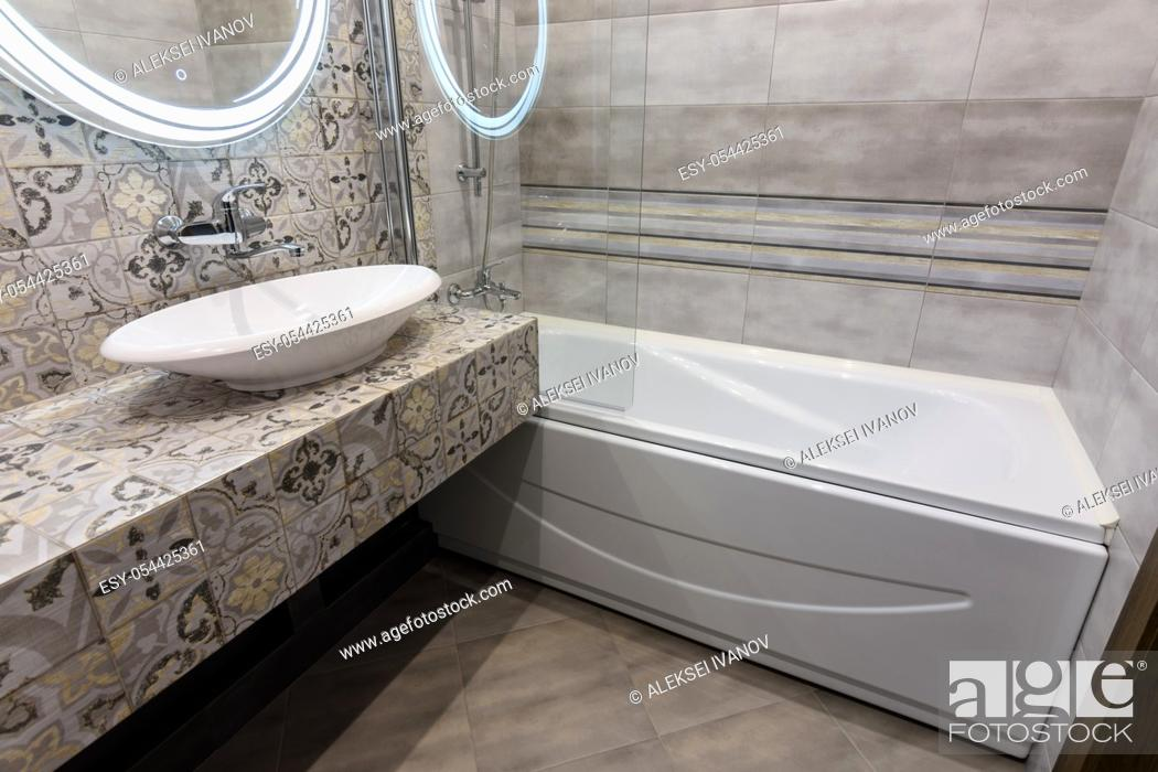Stock Photo: The interior of a stylish compact bathroom.