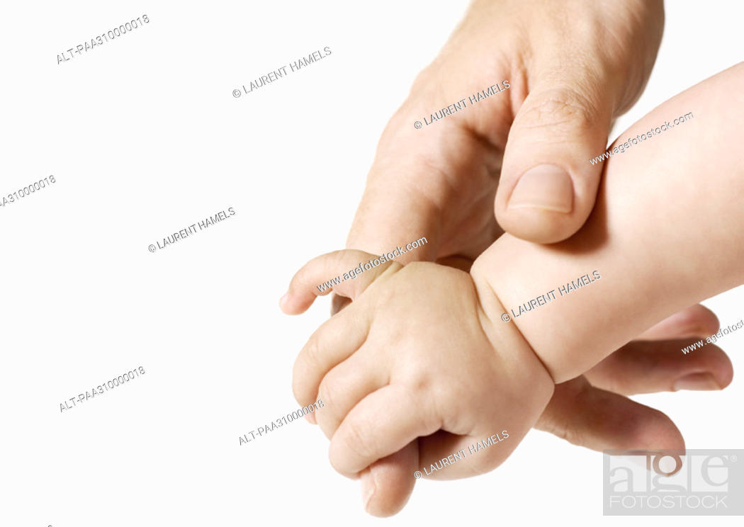 Stock Photo: Man's hand holding baby's hand.