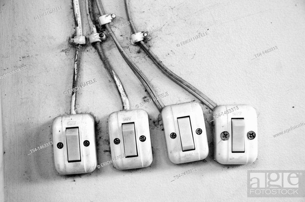 Stock Photo: Light switch in Cambodia.