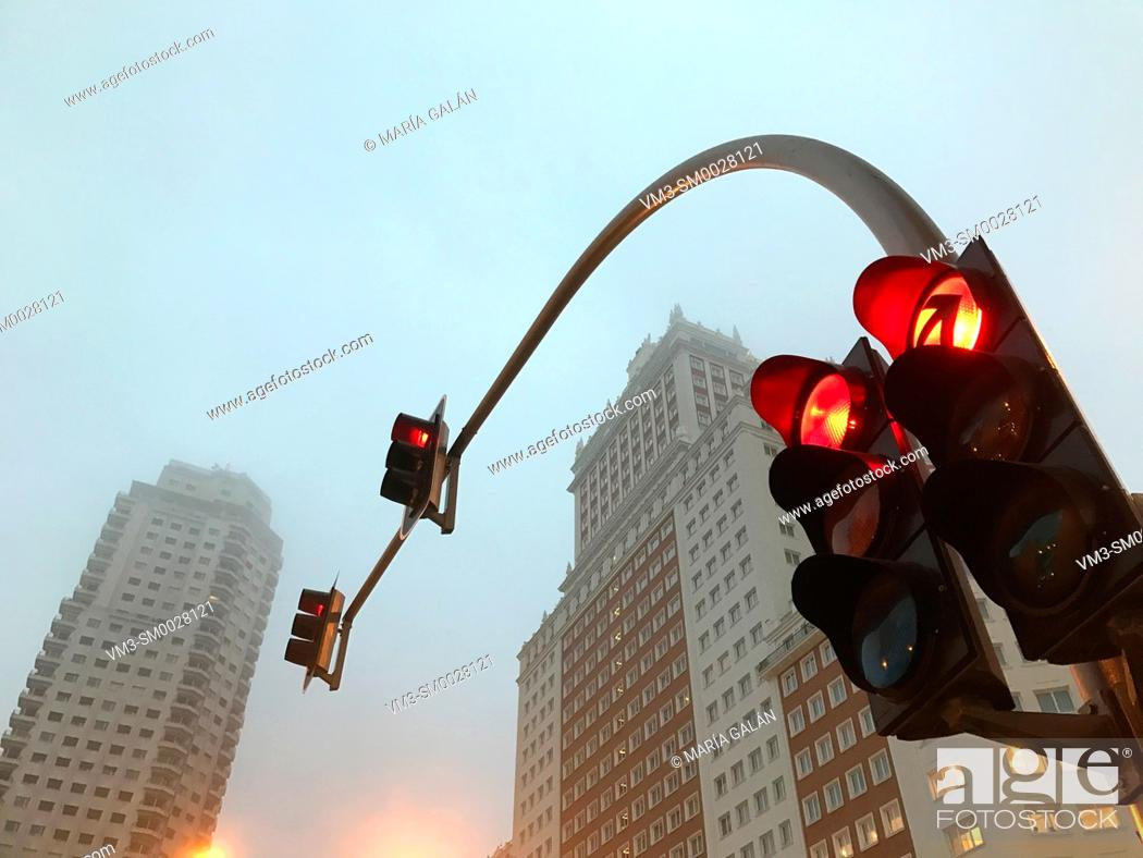 Stock Photo: Red traffic light and Plaza de España in the mist. Madrid, Spain.