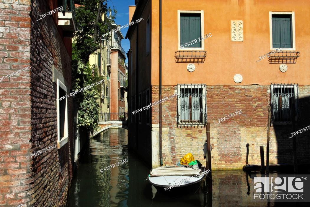 Stock Photo: Motorboat moored in Venice, Italy.