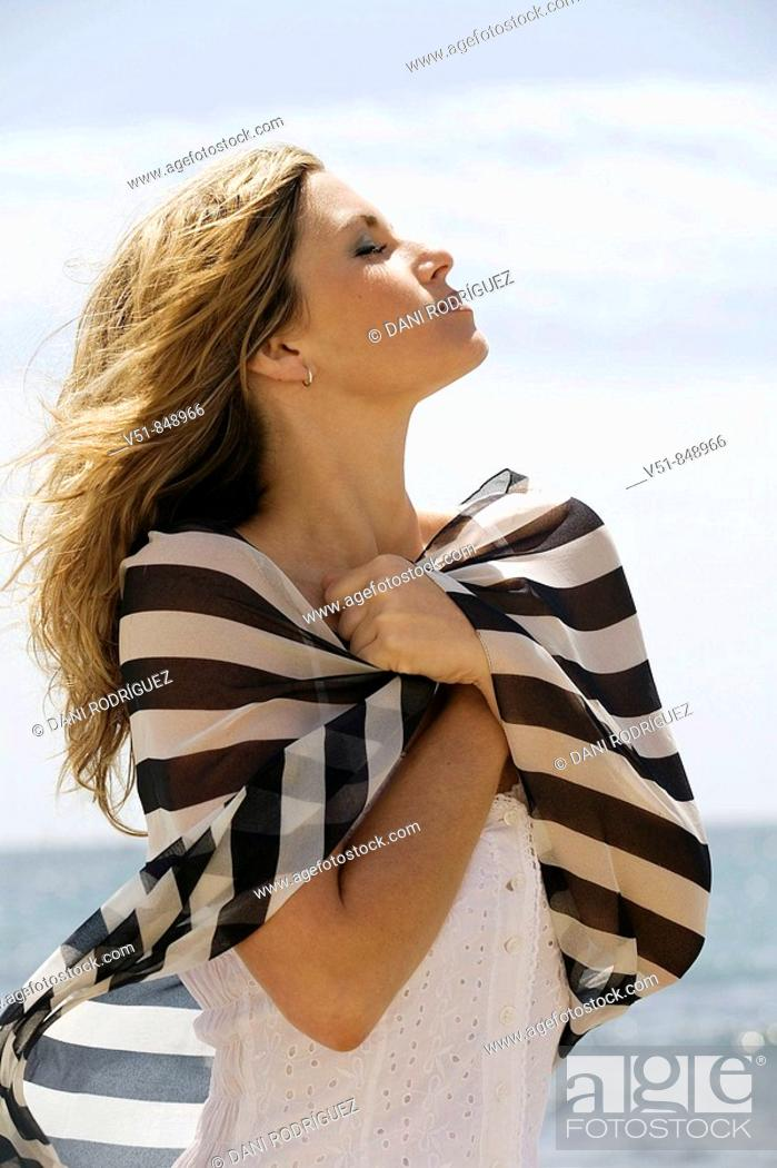 Stock Photo: Potrait of a woman by the sea.