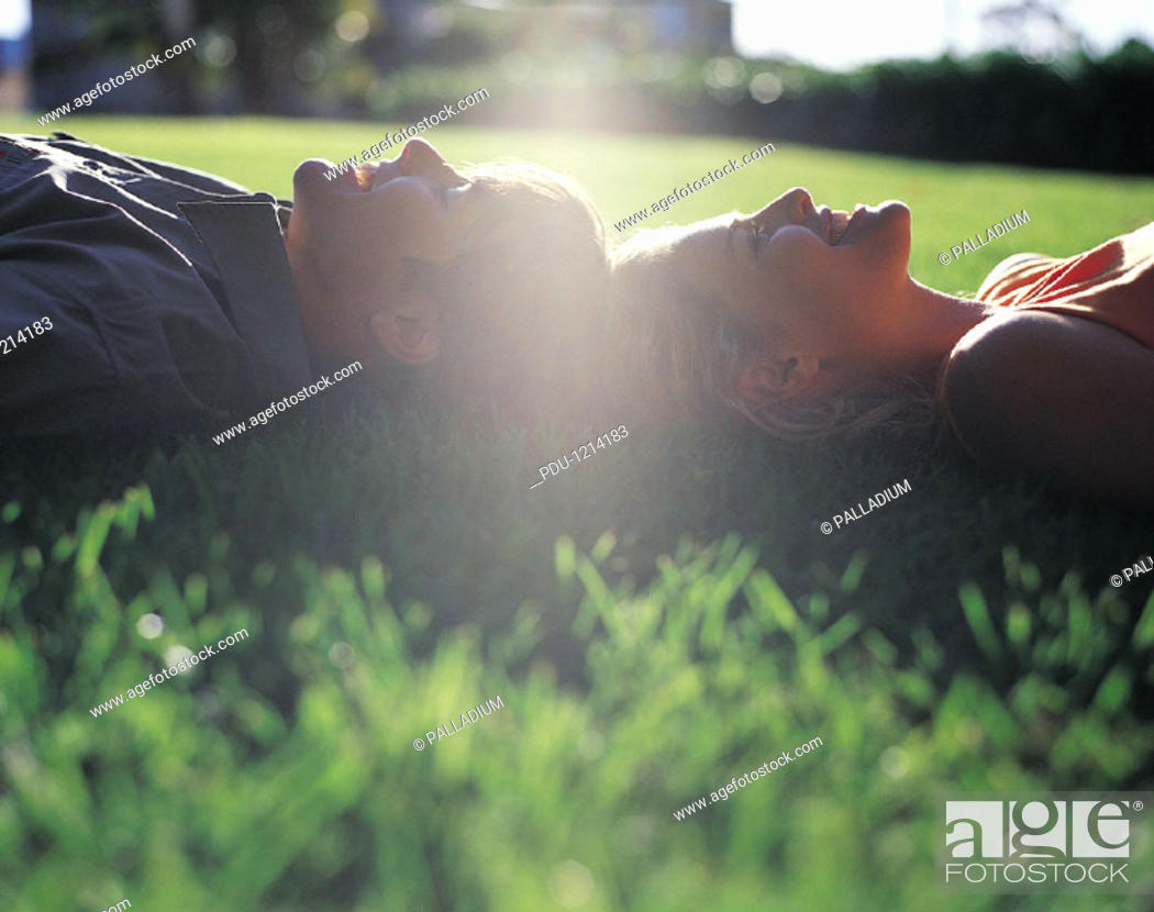Stock Photo: Couple Lying on the Grass.
