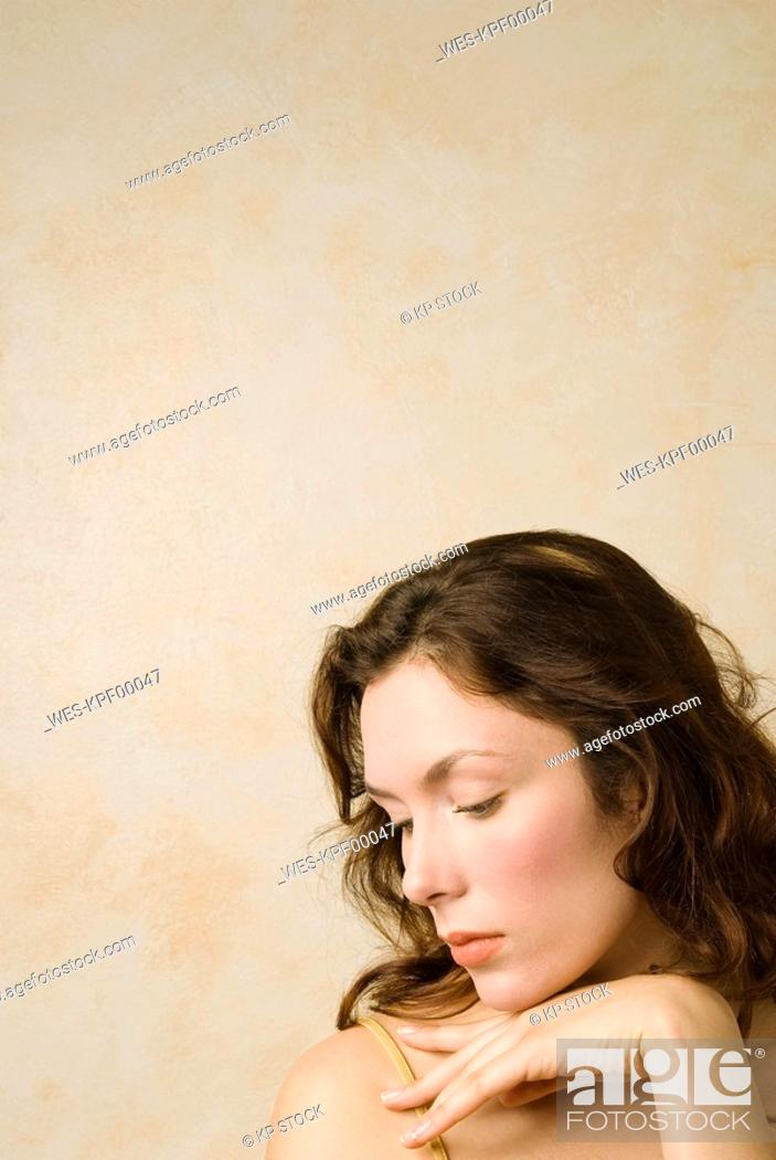 Stock Photo: Young woman musing, portrait, close up.