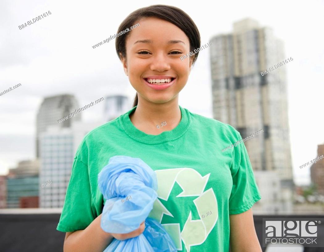 Stock Photo: Smiling mixed race teenage girl wearing recycling t-shirt.
