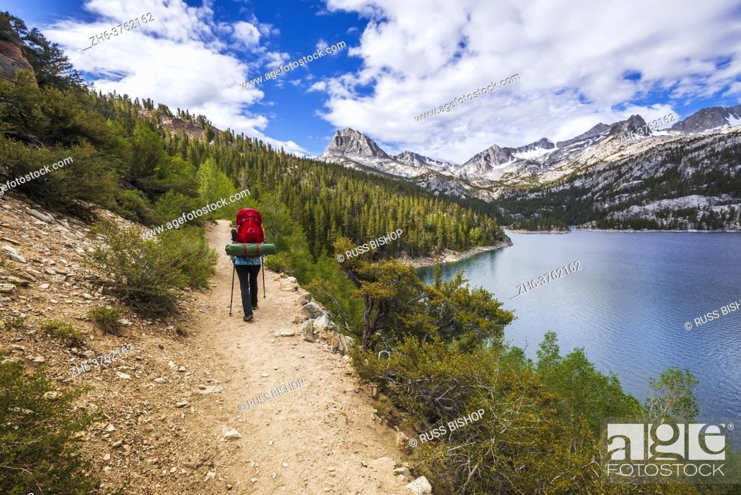 Stock Photo: Backpacker above South Lake, John Muir Wilderness, Sierra Nevada Mountains, California USA.