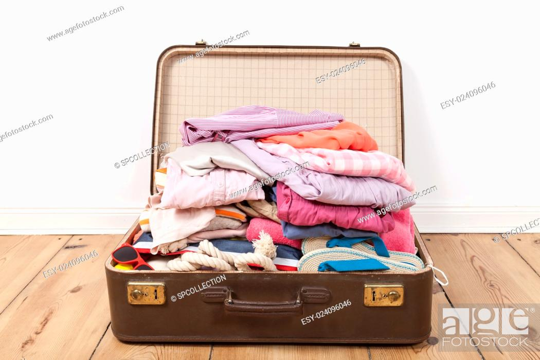 Stock Photo: Packed suitcase.