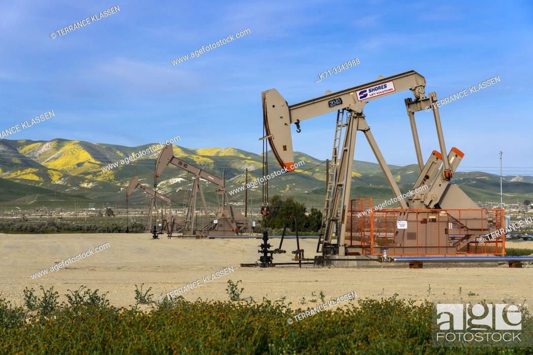Stock Photo: Oil pumpers in the oil fields near Taft, California, USA.