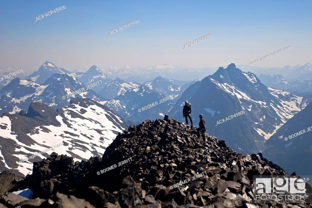 Stock Photo: Two climbers summit Elkhorn Mountain, Strathcona Park, Central Vancouver Island, British Columbia, Canada.