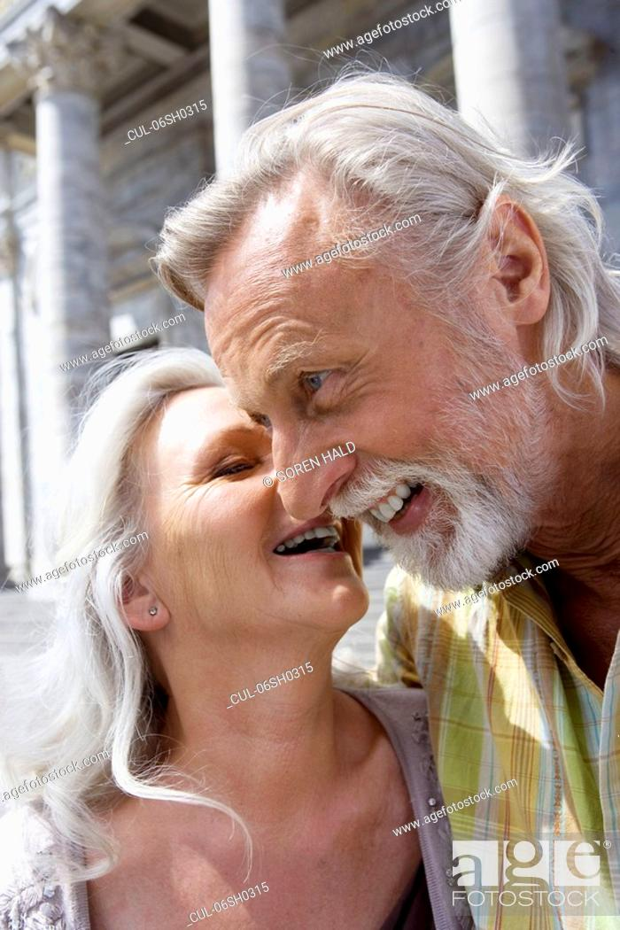 Stock Photo: Woman kissing man.