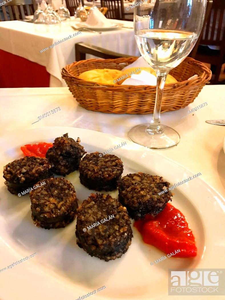 Stock Photo: Morcilla with red pepper serving. Burgos, Spain.