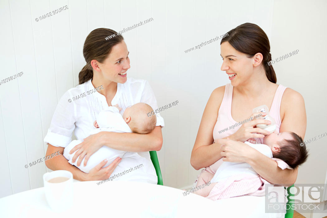 Stock Photo: Two mothers with their babies.