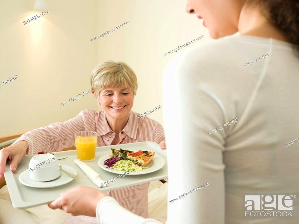 Stock Photo: Woman getting lunch served in bed.