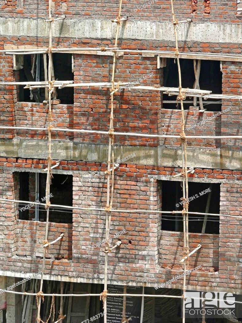 Stock Photo: Building under construction, Pune, Maharashtra, India.
