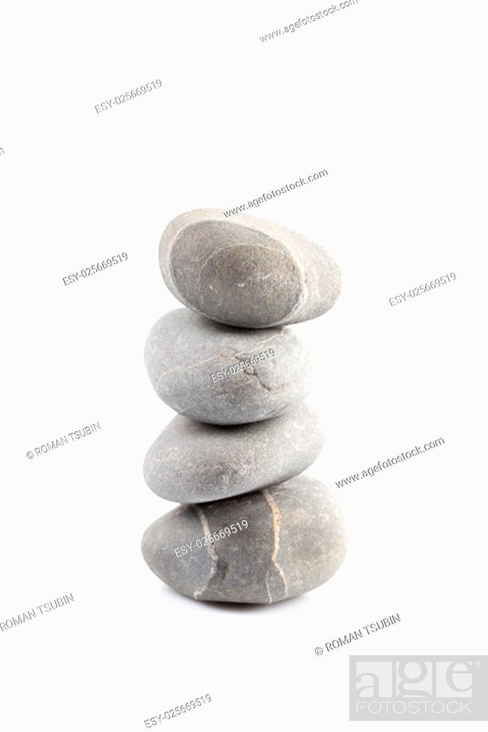 Stock Photo: Pyramid of stones over white with reflection shadow.