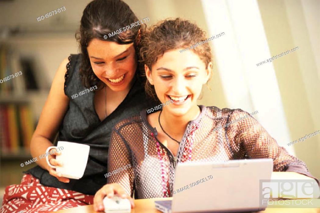 Stock Photo: Girls at computer.
