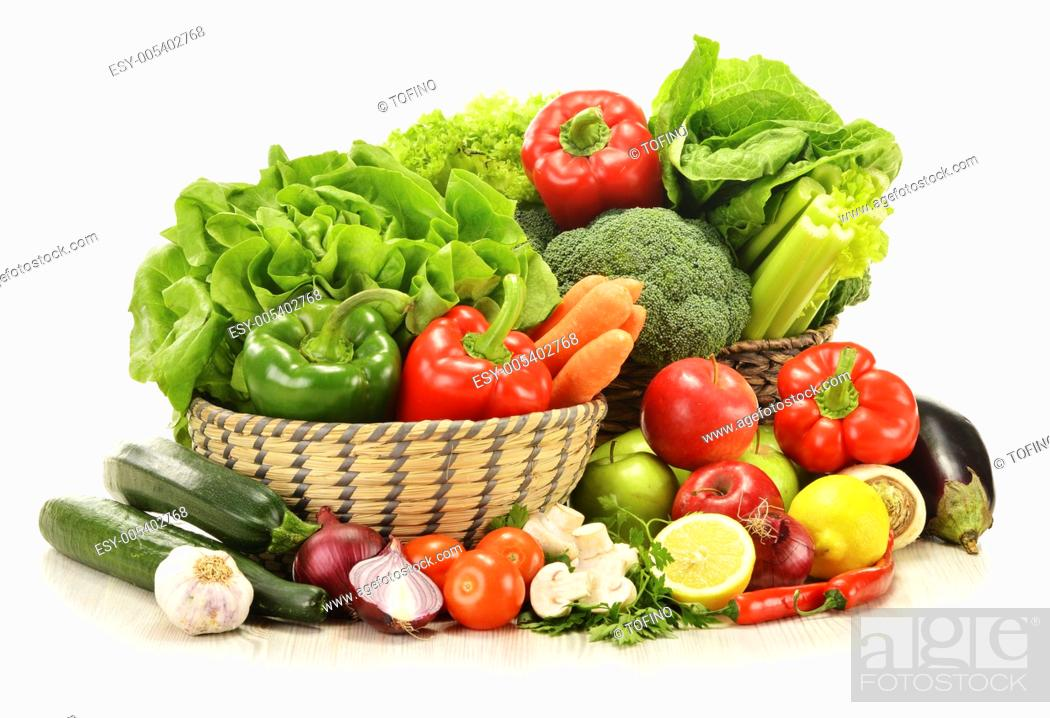 Stock Photo: Composition with raw vegetables in wicker basket isolated on white.